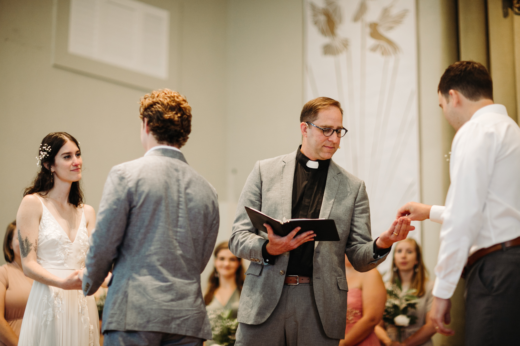Pastor giving the rings during a downtown knoxville wedding at redeemer church