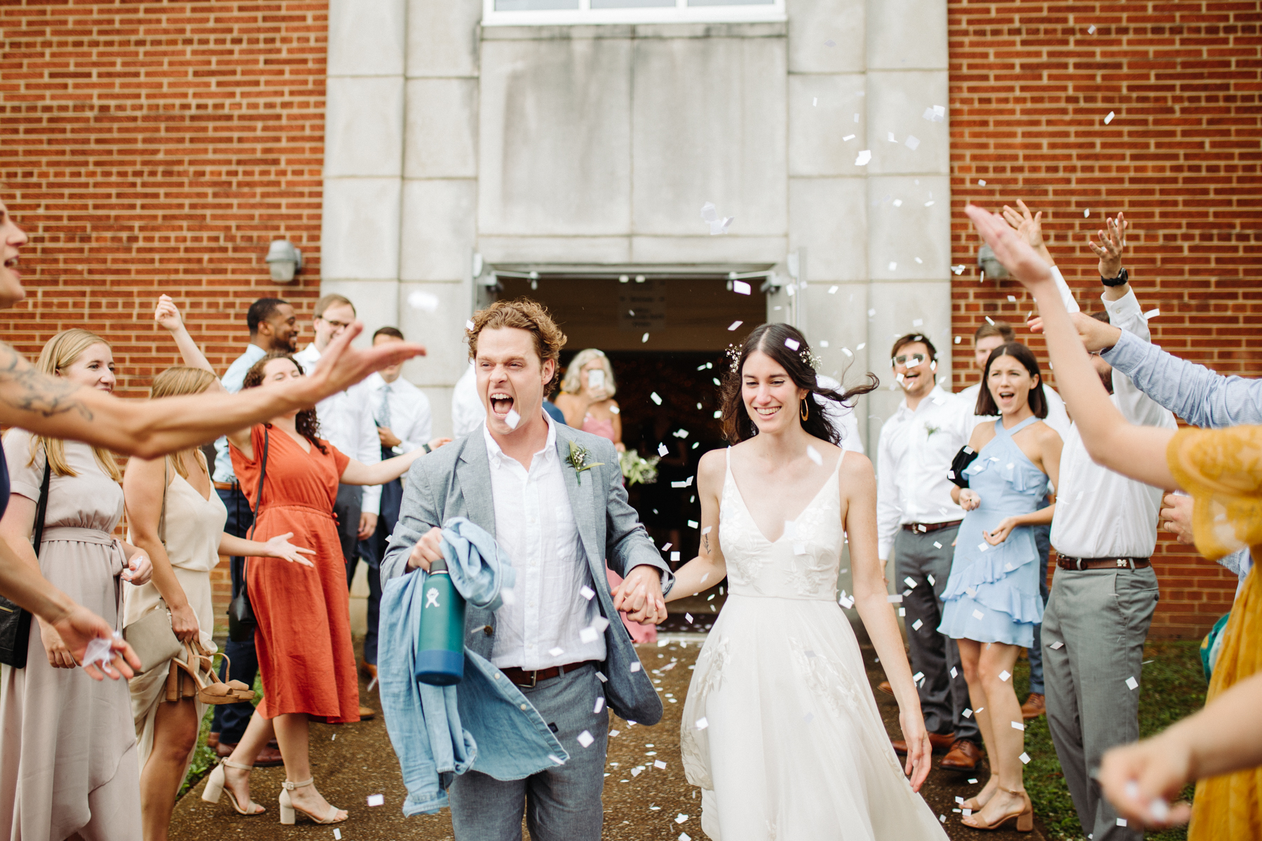 Paper confetti exit after a downtown knoxville wedding at redeemer church