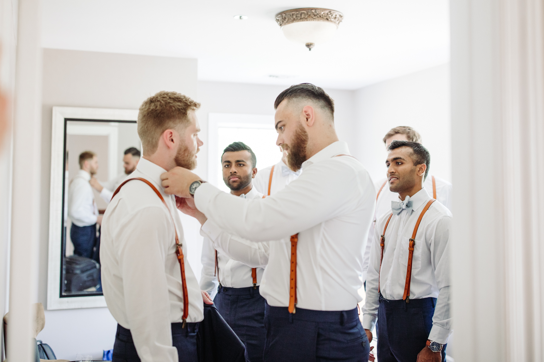 groomsmen getting ready at a Sunny summer wedding at Dara's Garden in Knoxville, Tennessee