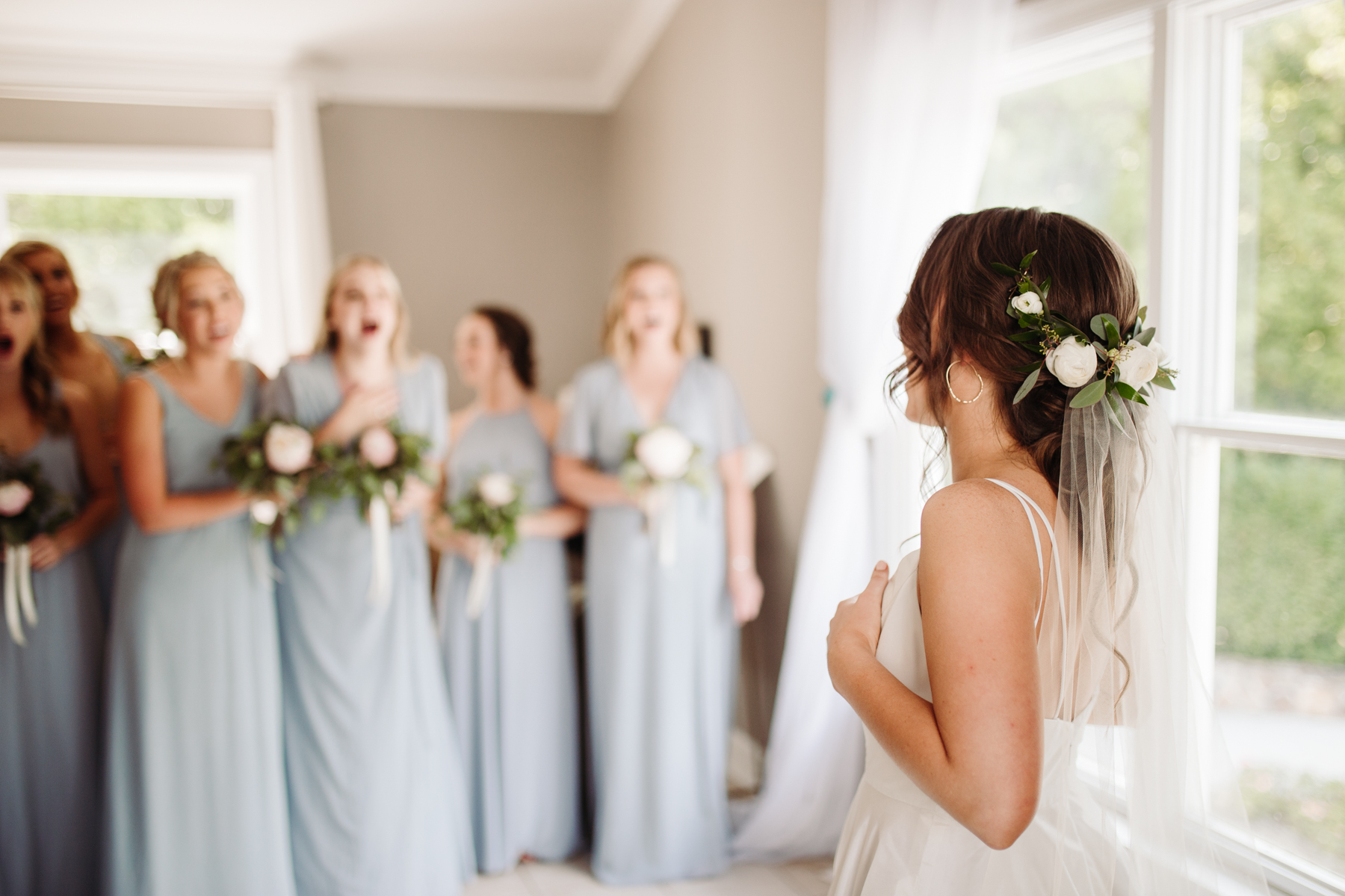 Bridesmaid reveal before a Sunny summer wedding at Dara's Garden in Knoxville, Tennessee