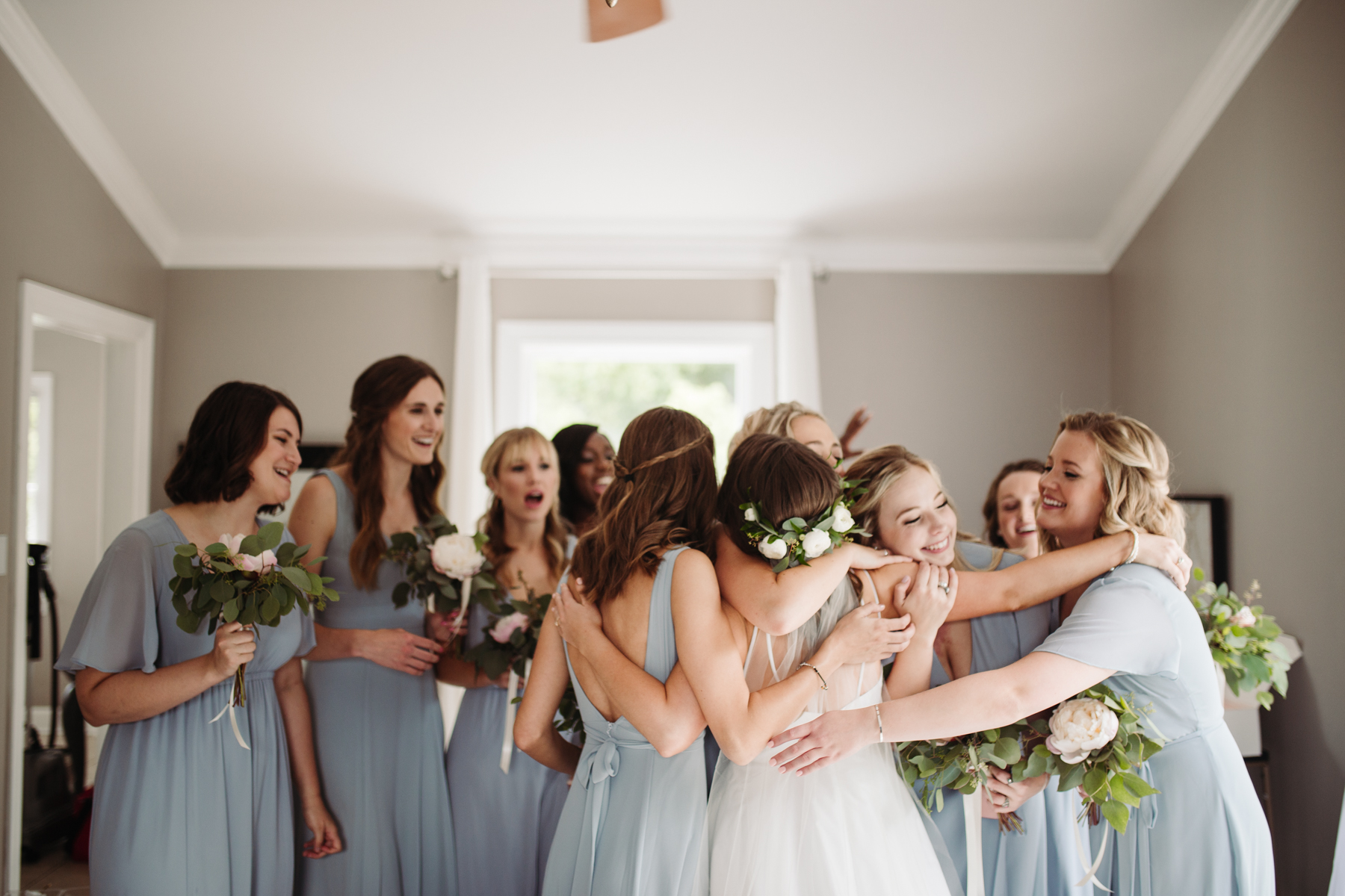 Bridesmaids reveal before a Sunny summer wedding at Dara's Garden in Knoxville, Tennessee