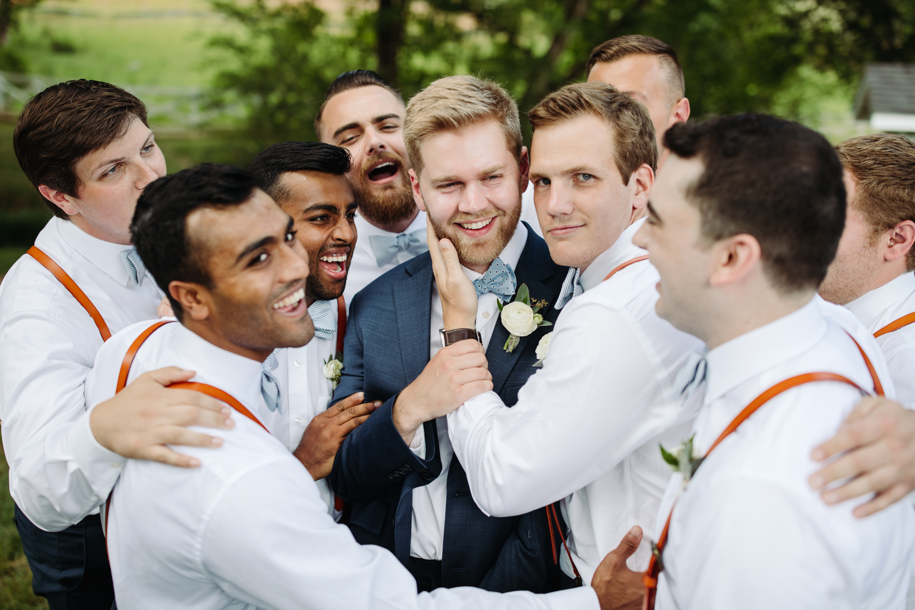 groom and groomsmen portraits before a Sunny summer wedding at Dara's Garden in Knoxville, Tennessee