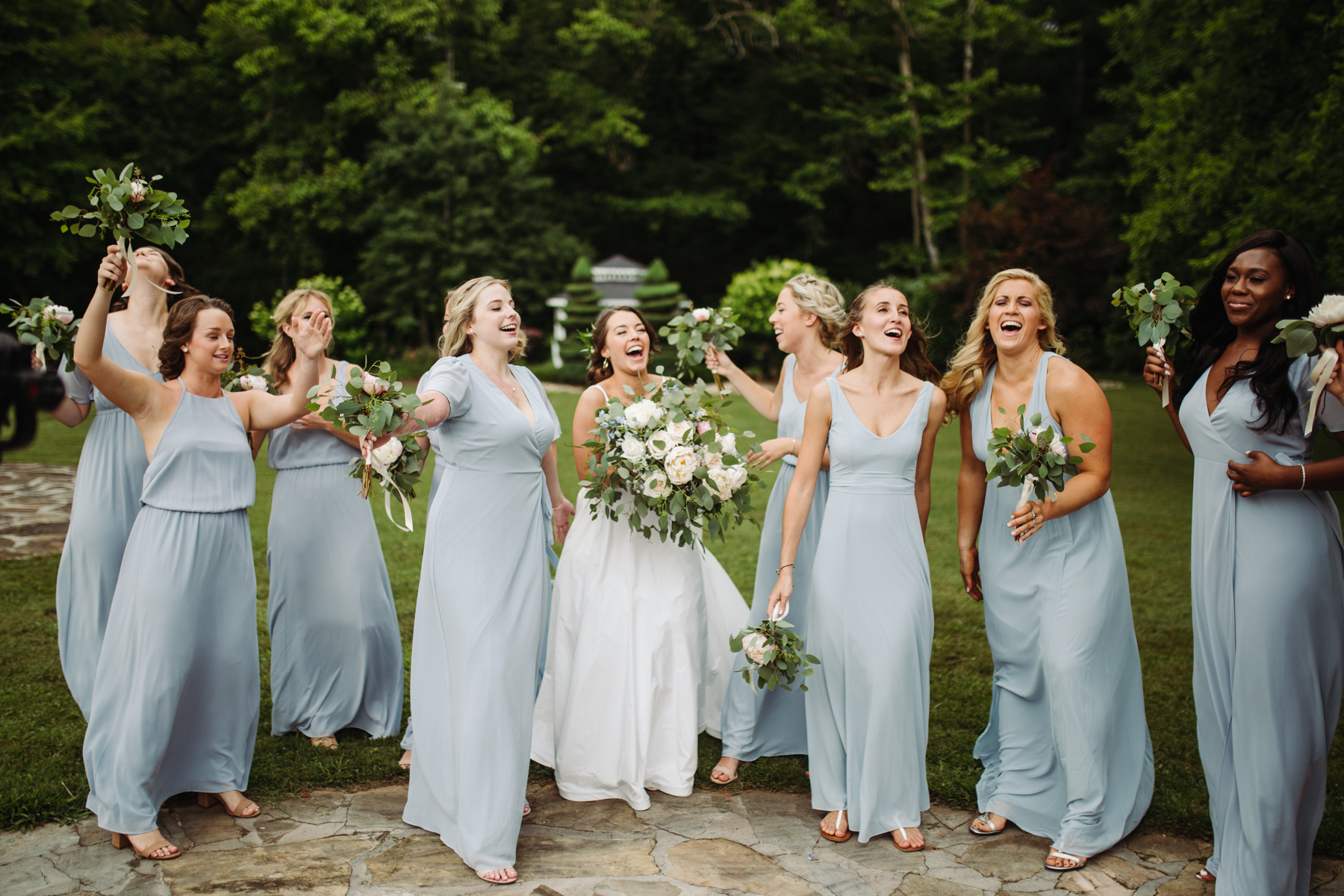 Bride and bridesmaid photos at a Sunny summer wedding at Dara's Garden in Knoxville, Tennessee