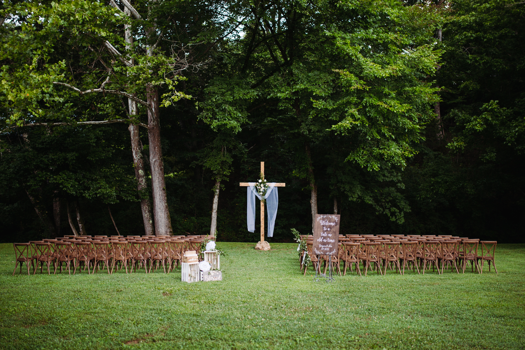 Ceremony set up at Sunny summer wedding at Dara's Garden in Knoxville, Tennessee