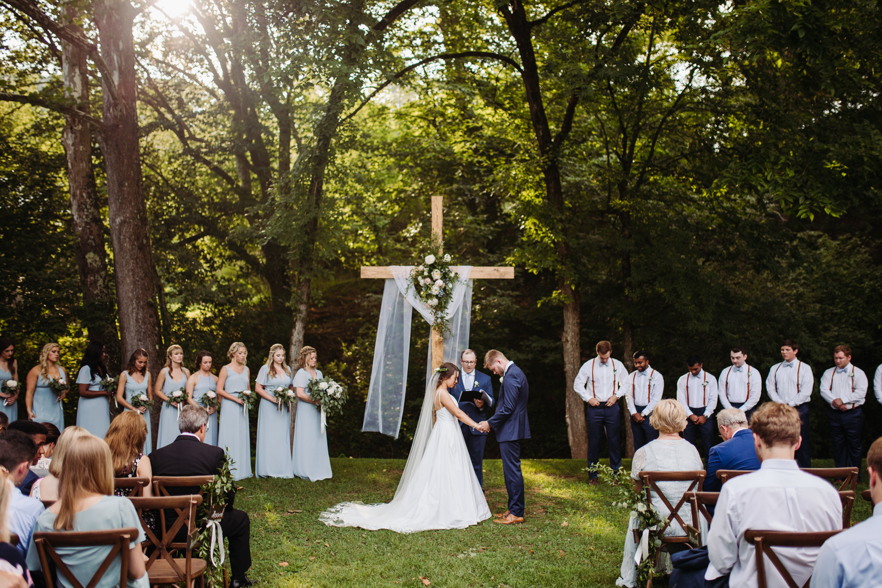 Evening ceremony of a Sunny summer wedding at Dara's Garden in Knoxville, Tennessee