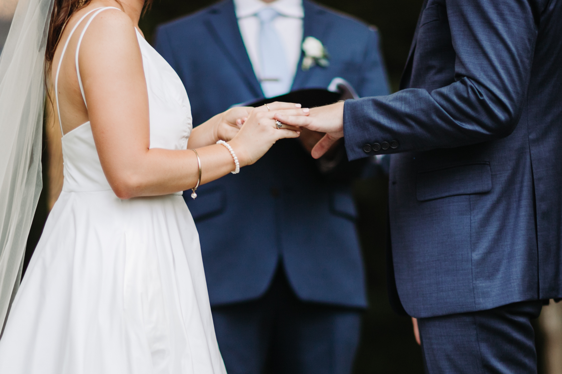 Bride and groom exchanging rings at a Sunny summer wedding at Dara's Garden in Knoxville, Tennessee