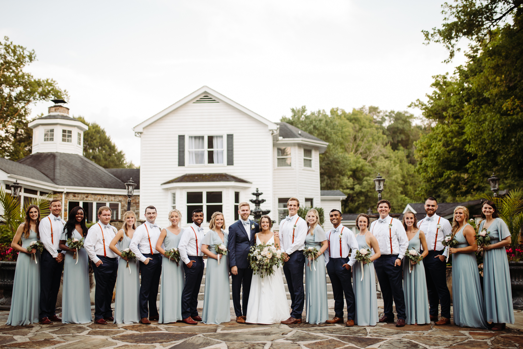 Full bridal party photos at a Sunny summer wedding at Dara's Garden in Knoxville, Tennessee