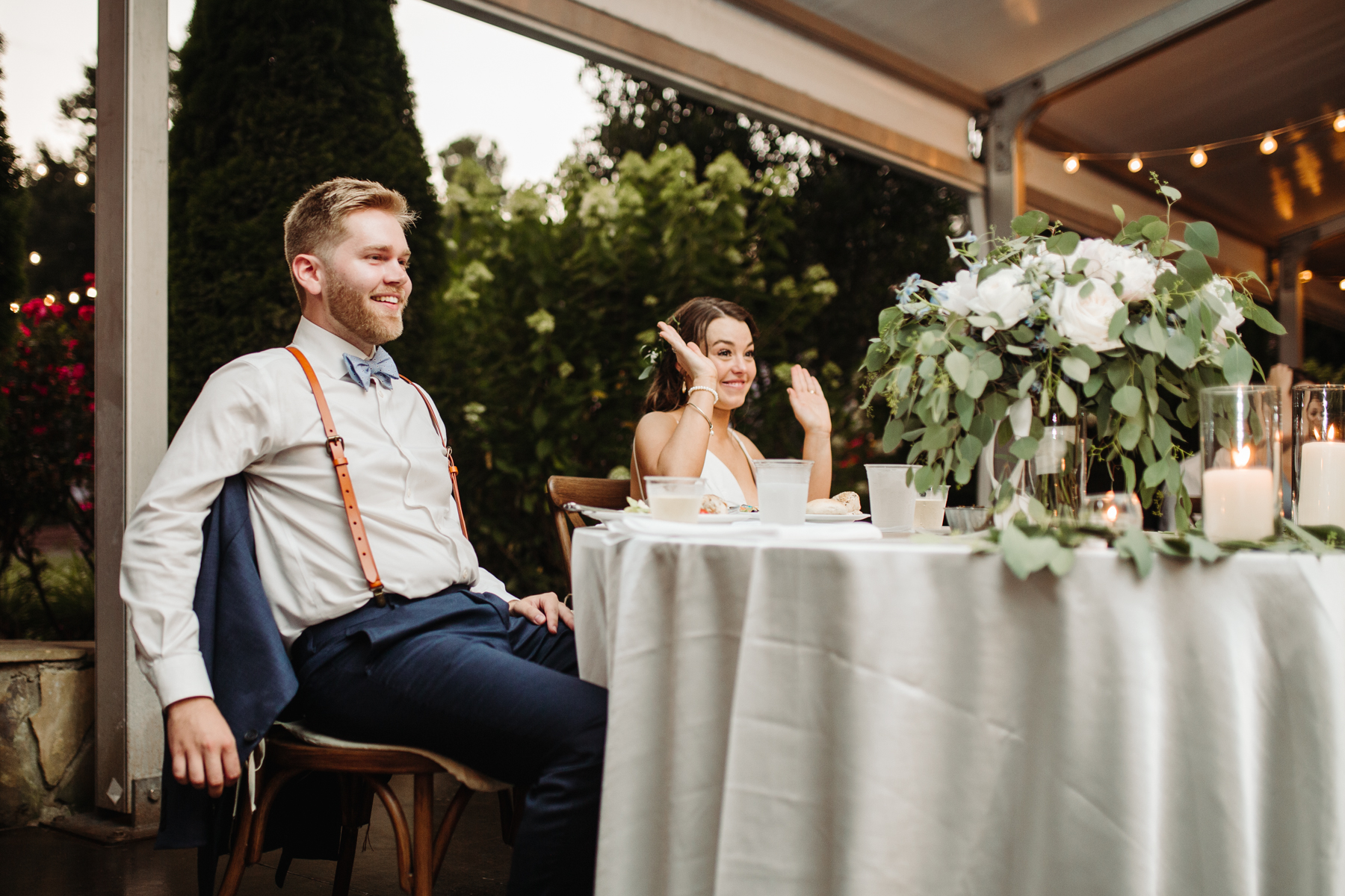 Toasts during the reception of a Sunny summer wedding at Dara's Garden in Knoxville, Tennessee