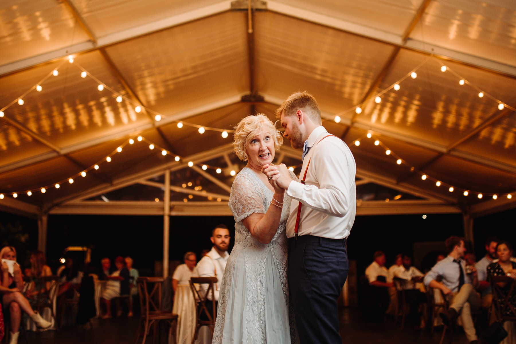 mother son dance during the reception of a Sunny summer wedding at Dara's Garden in Knoxville, Tennessee