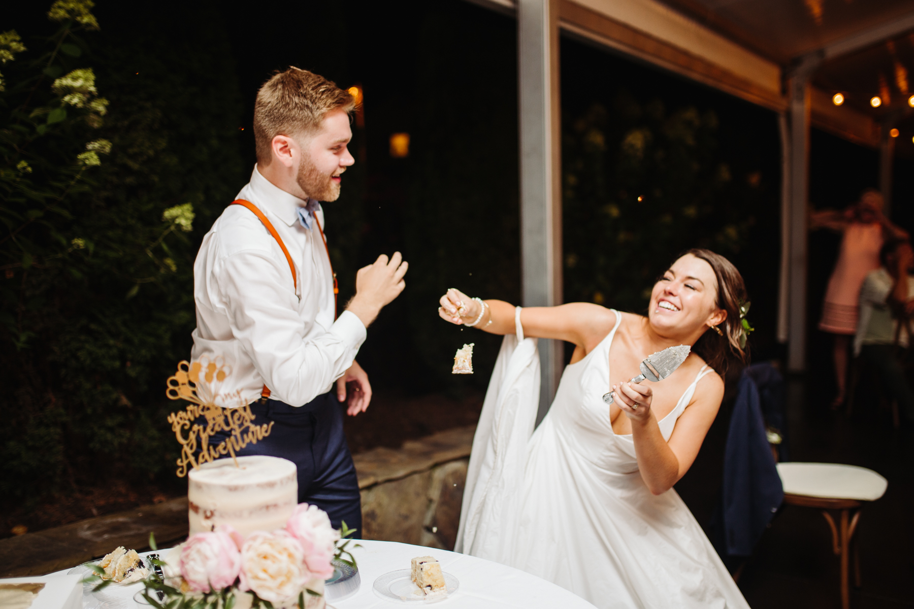 cutting the cake during a reception of a Sunny summer wedding at Dara's Garden in Knoxville, Tennessee
