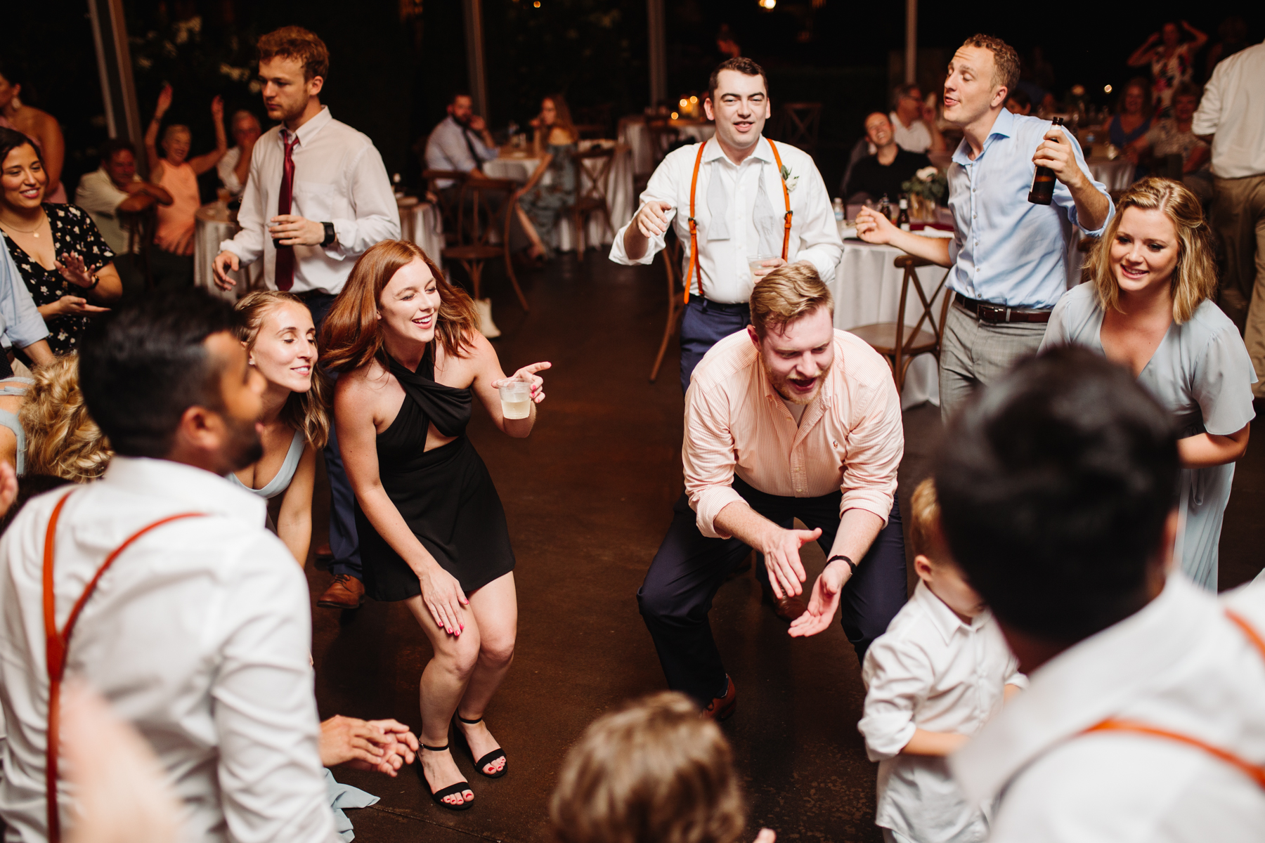 dance floor during the reception of a Sunny summer wedding at Dara's Garden in Knoxville, Tennessee
