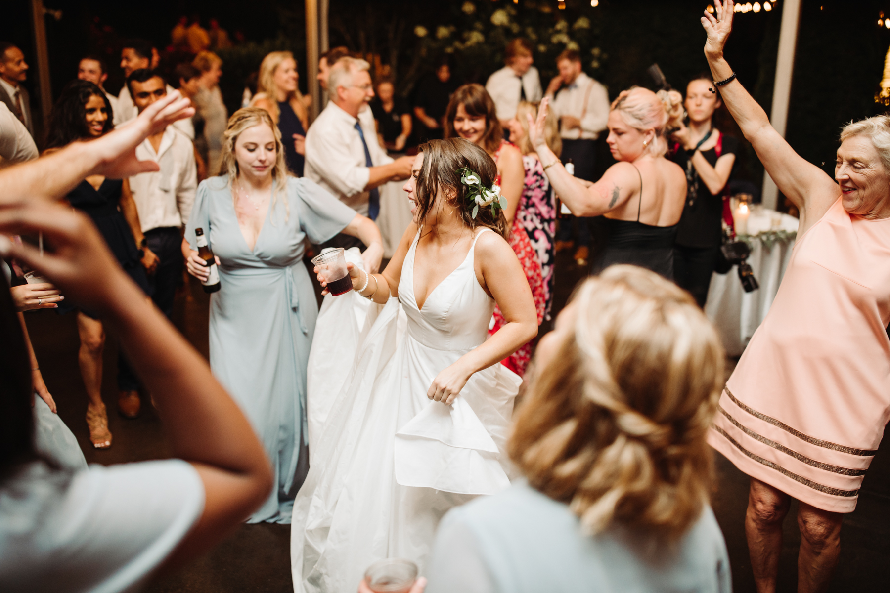 bride on the dance floor at a reception of a Sunny summer wedding at Dara's Garden in Knoxville, Tennessee