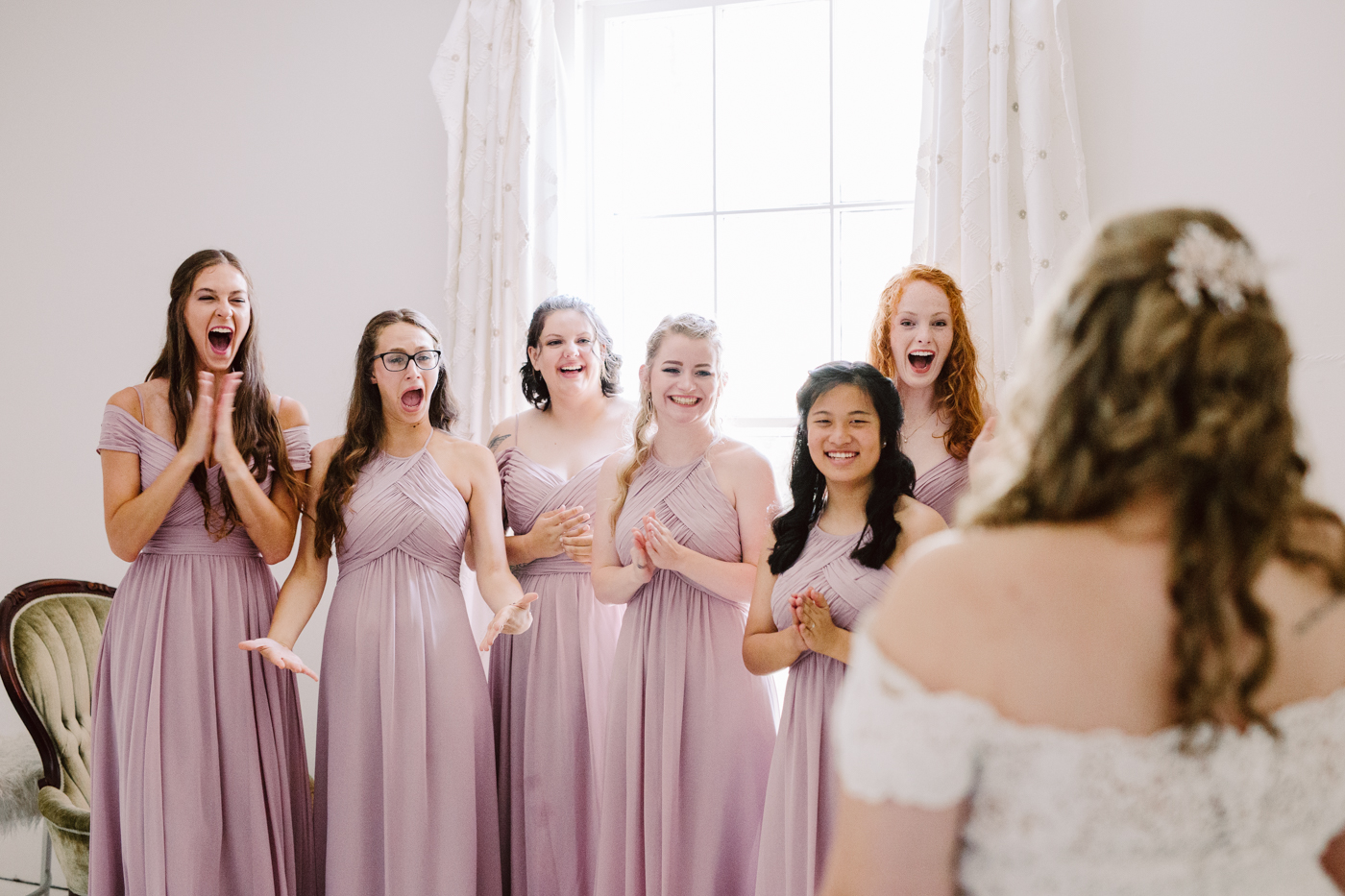 bridesmaids reveal before a sunny summer wedding at the venue at twin oaks in tennessee