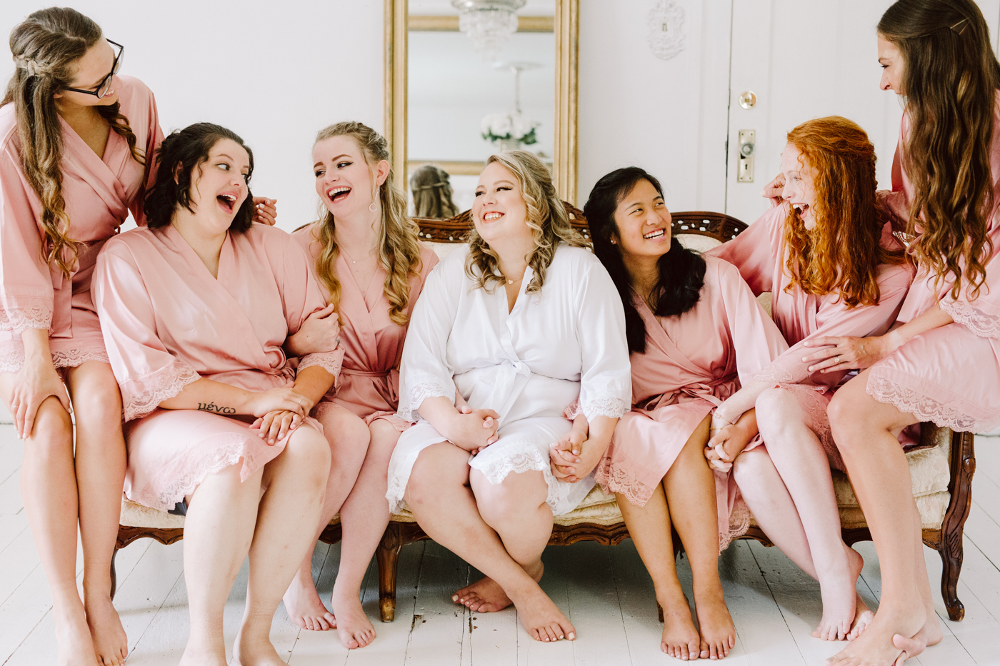 bridesmaid portraits in the suite before a sunny summer wedding at the venue at twin oaks in tennessee
