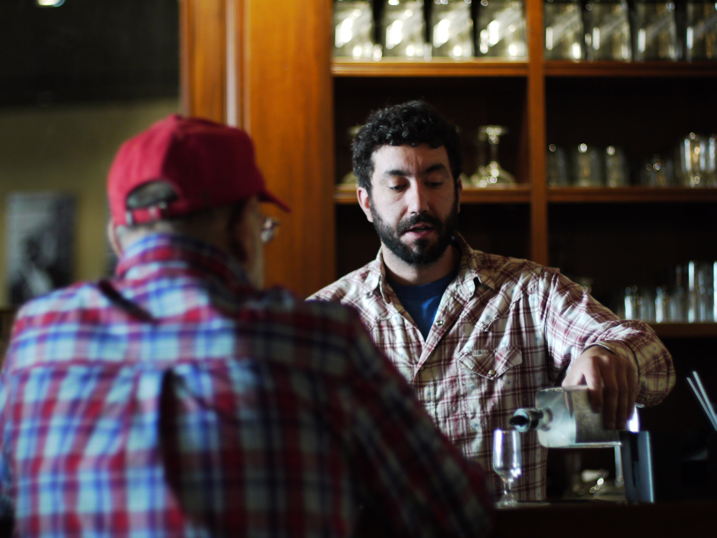 Mike pours a sample of craft spirits at Montgomery micro-distillery
