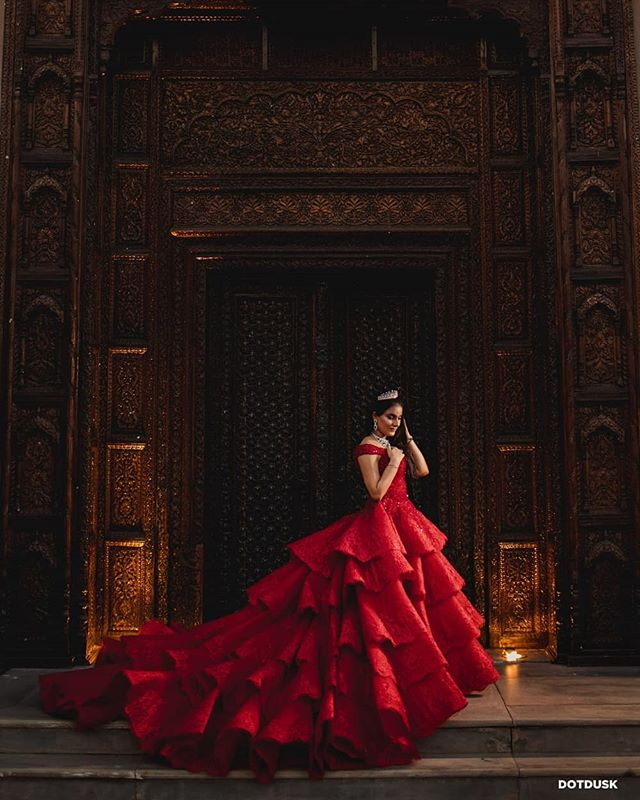 Sukhmani looked nothing less than a dream in a stunning scarlet red couture by @michael5inco for her Cocktail Night.  Photograph by @sundeepsingh for @dotdusk Planned & Managed by: @baraatiinc Makeup Artist: @amritkaur_artistry Jewellery: @motiwalaandsons  #michaelcinco #dotduskbride #dotdusk #lookslikefilmweddings #indianbride #reddress #kikieinlove @kikieinlove #thecrimsonbride