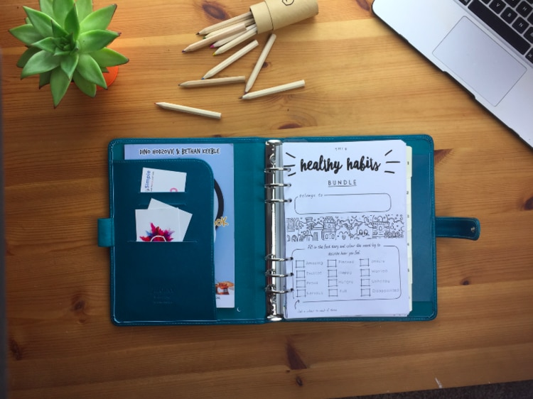 Step 16. Once you have successfully hole punched the whole of the Pre7tySimple planner, you can slot the pages into an A5 filofax (as seen in the photograph) and you are ready to go!