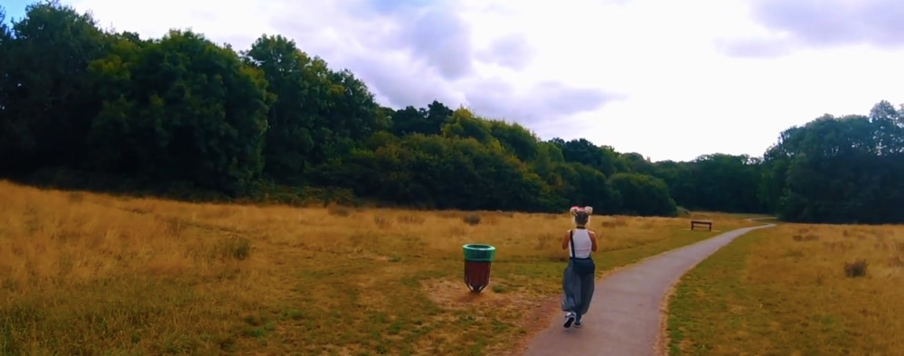 Photograph taken of Beth walking along a path, whilst we were filming Walk of the Week in Rhydypenau Park, Cardiff. The sun is shining, but where is Marley?
