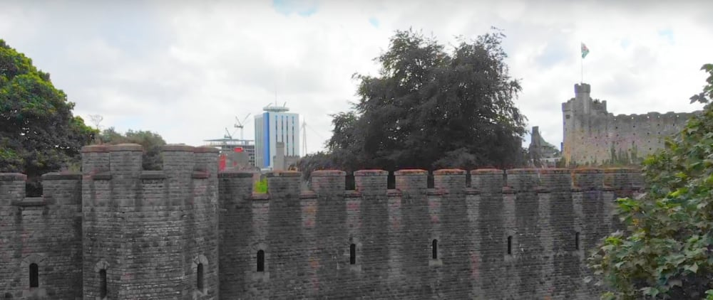 Screenshot taken from Walk of the Week, ep 5. Bute Park. Cardiff Castle walls, with the city in the background.