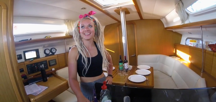 Beth smiling, inside the saloon of a 36 foot yacht during a weekend Start Yachting course with Pembrokeshire Cruising.