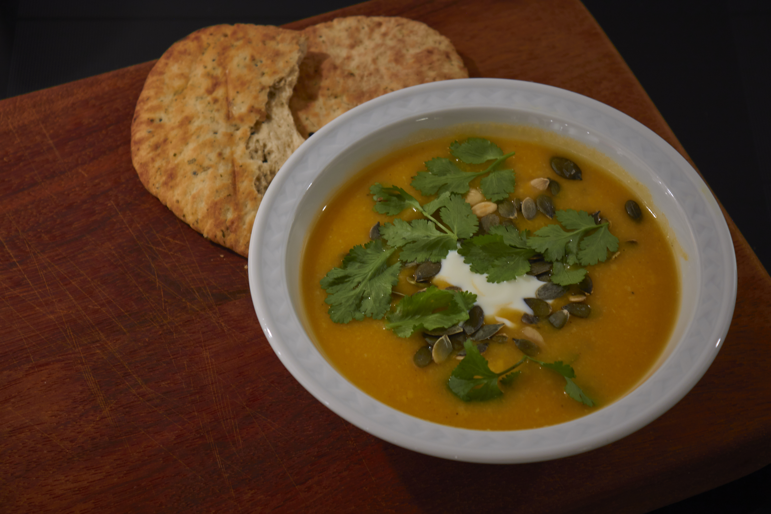 Curried Butternut Squash Soup - serve the finished soup with yogurt, pumpkin seeds, coriander and naan | In Carina's Kitchen
