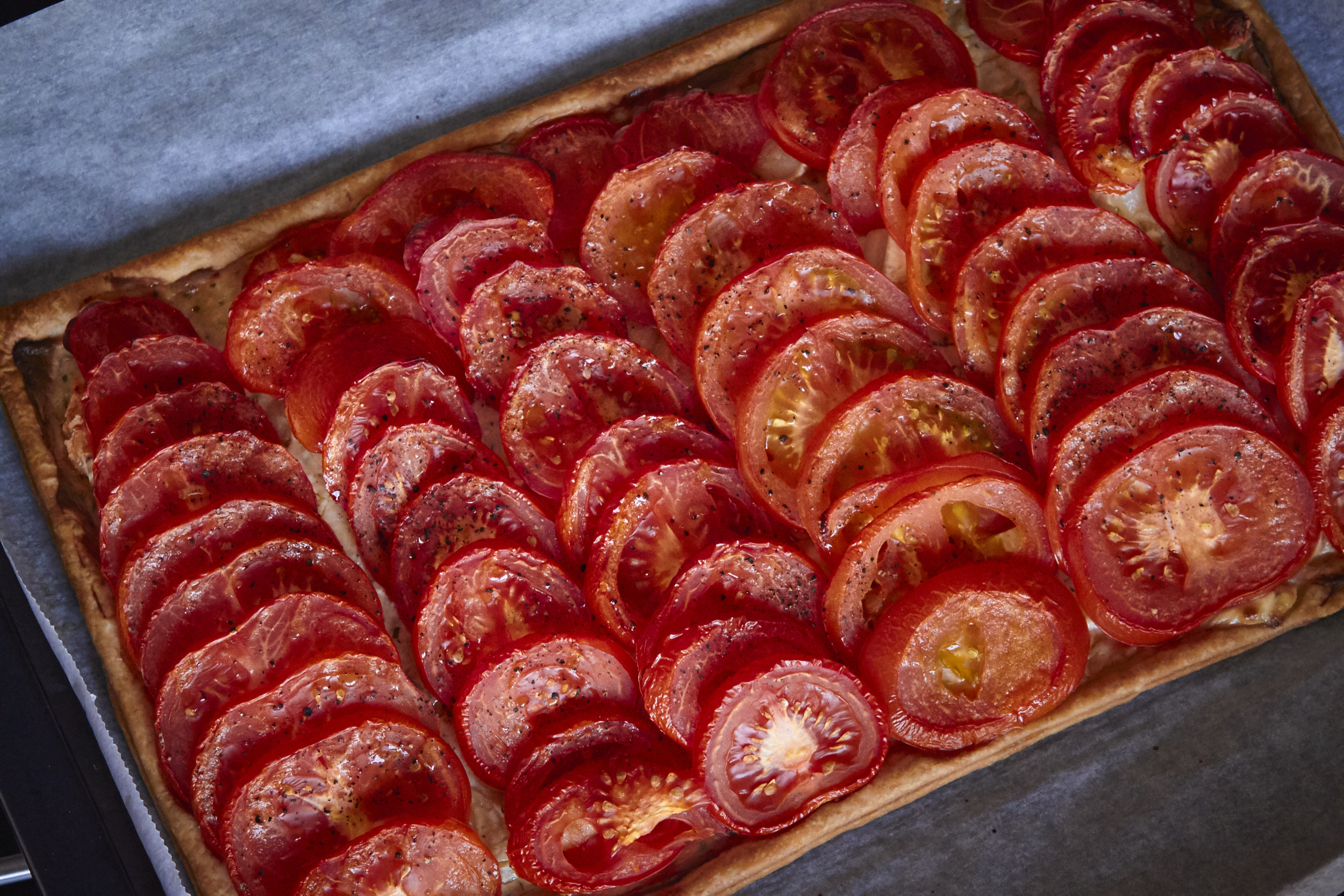 Tomato & Goat Cheese Tart - the tart right out of the oven with the beautiful roast tomatoes | In Carina's Kitchen