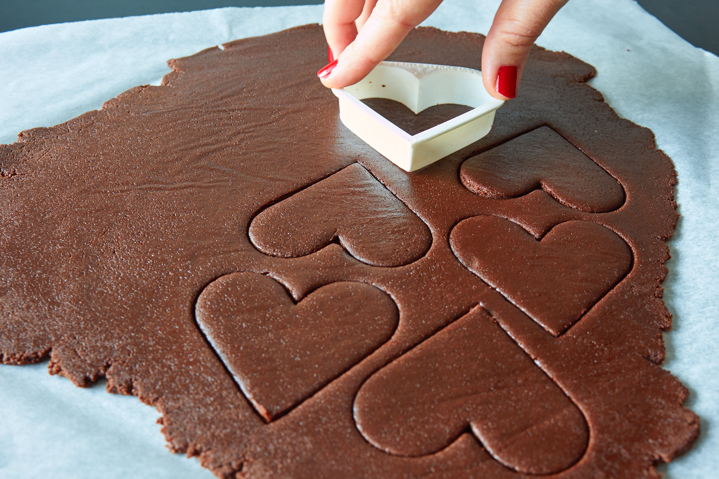 Homemade Oreo Cookies - cutting out the cookies with a heart-shaped cutter | In Carina's Kitchen