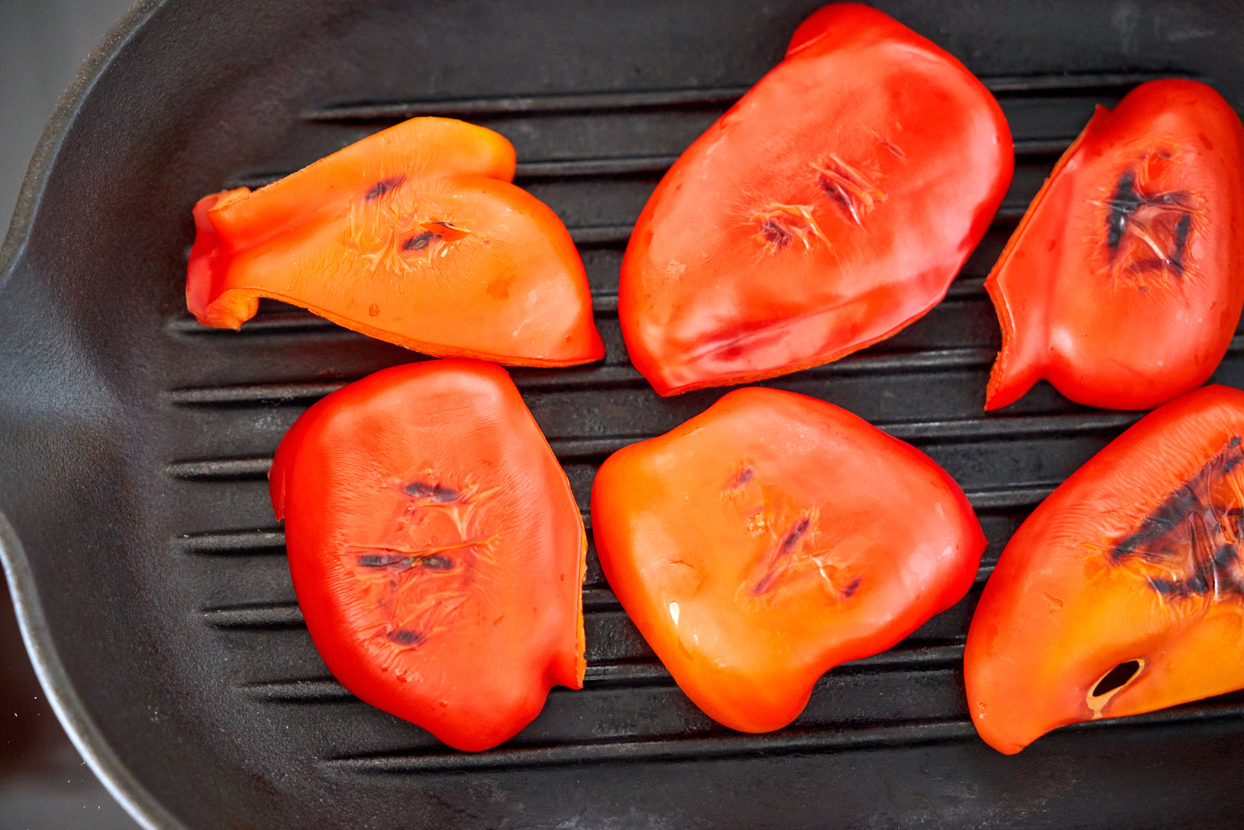 Roasted Red Pepper Pesto - red pepper grilling in progress | In Carina's Kitchen