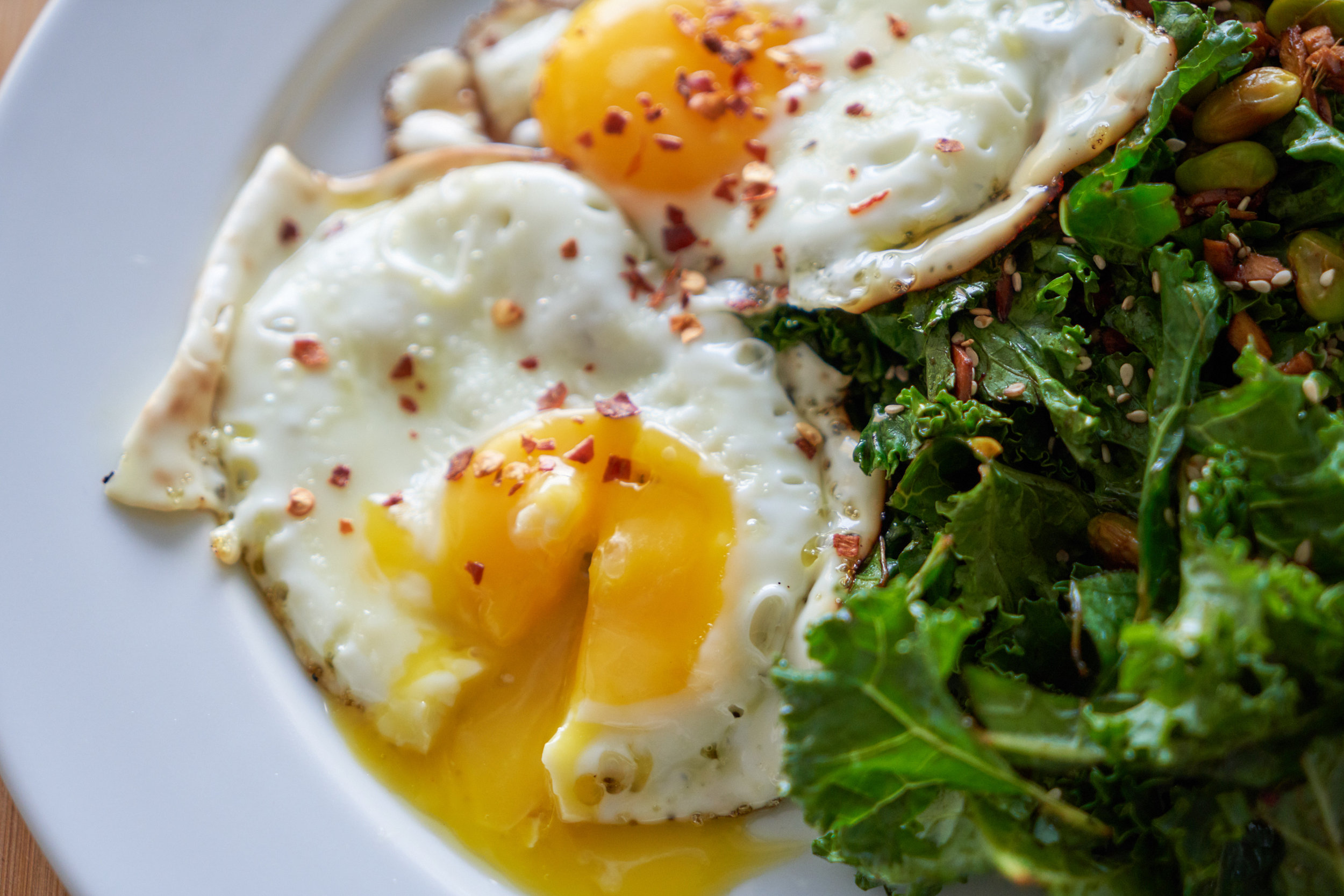 Meat-Free Monday Meal Prep | Full Day Meal Plan - lunch: fried eggs with sautéed kale, edamame beans and ginger | In Carina's Kitchen