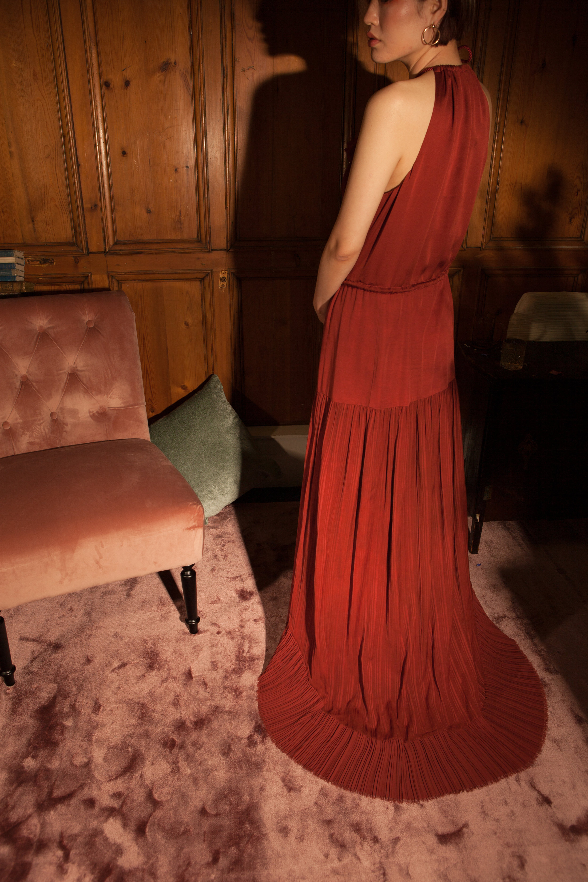 Floor length red gown by Baue