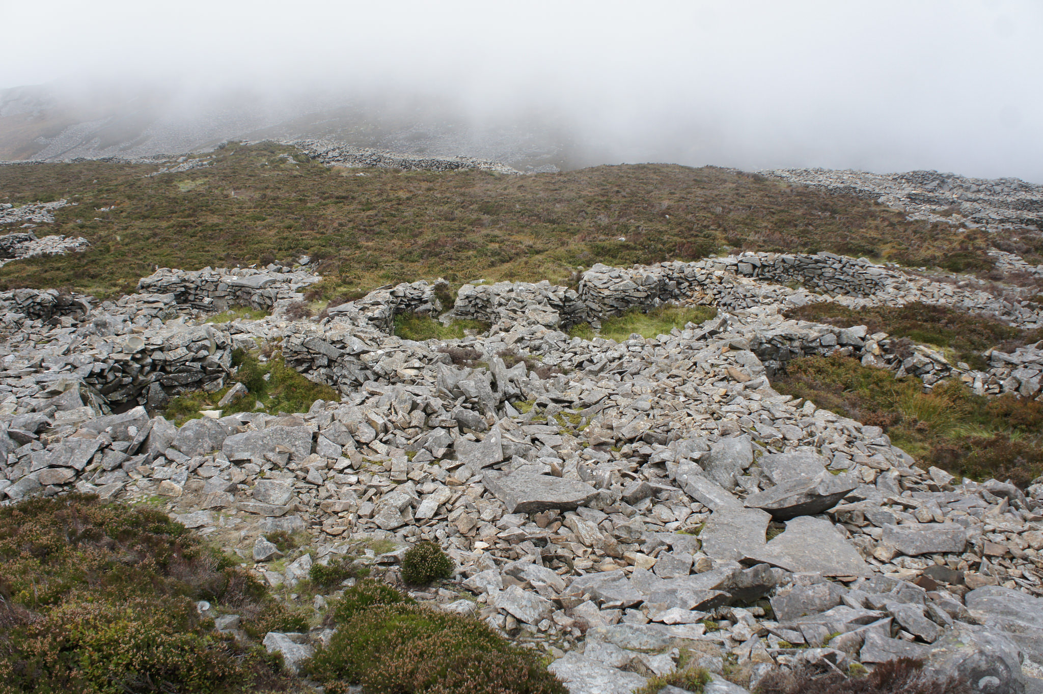 Tre'r Ceiri (Town of the Giants) on the Llŷn Peninsula. Suggested as a location for Caer Dathl, the court of Math fab Mathonwy in the 4th Branch.