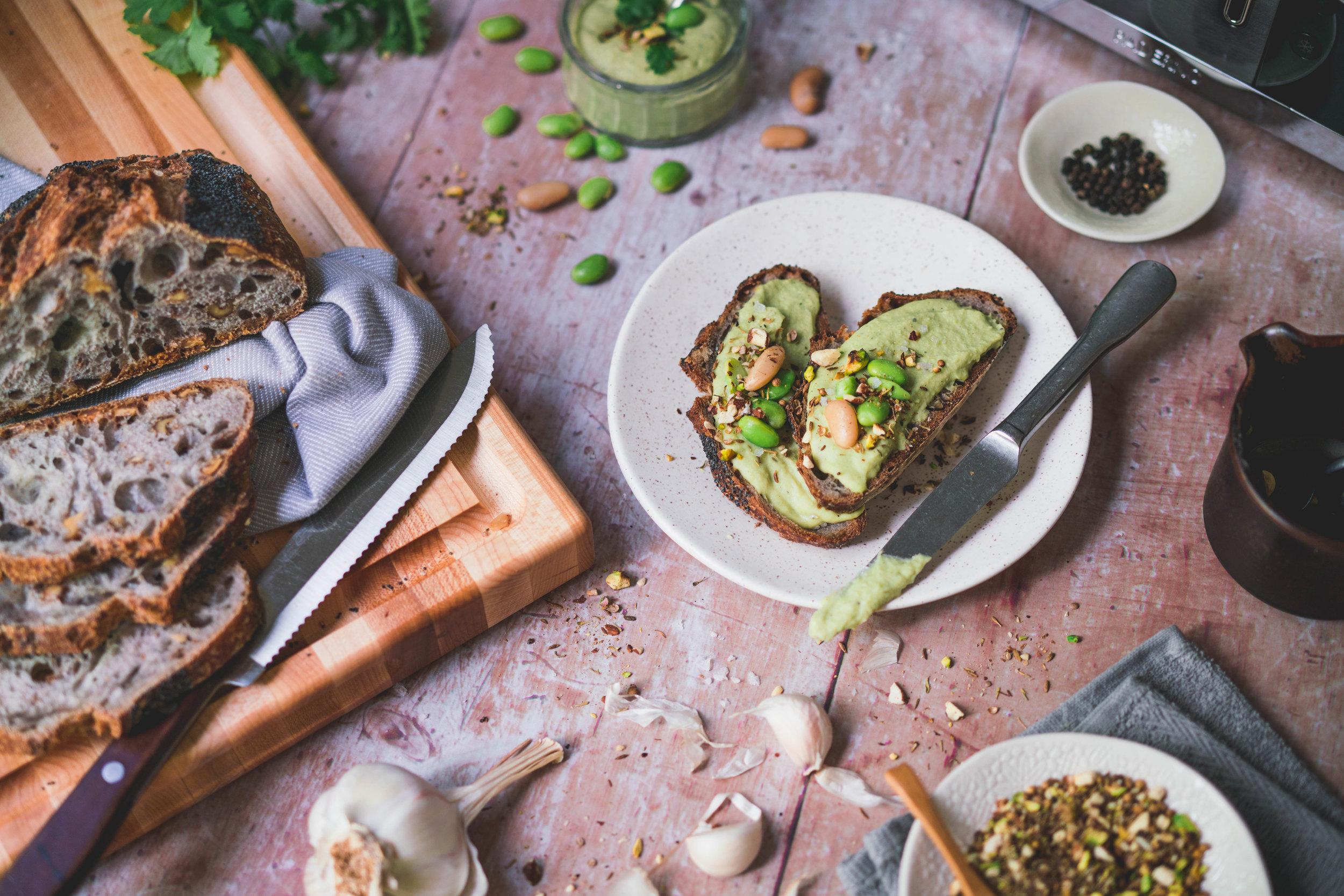 White Bean, Edamame & Cilantro spread on toasts, with dukkah spices.