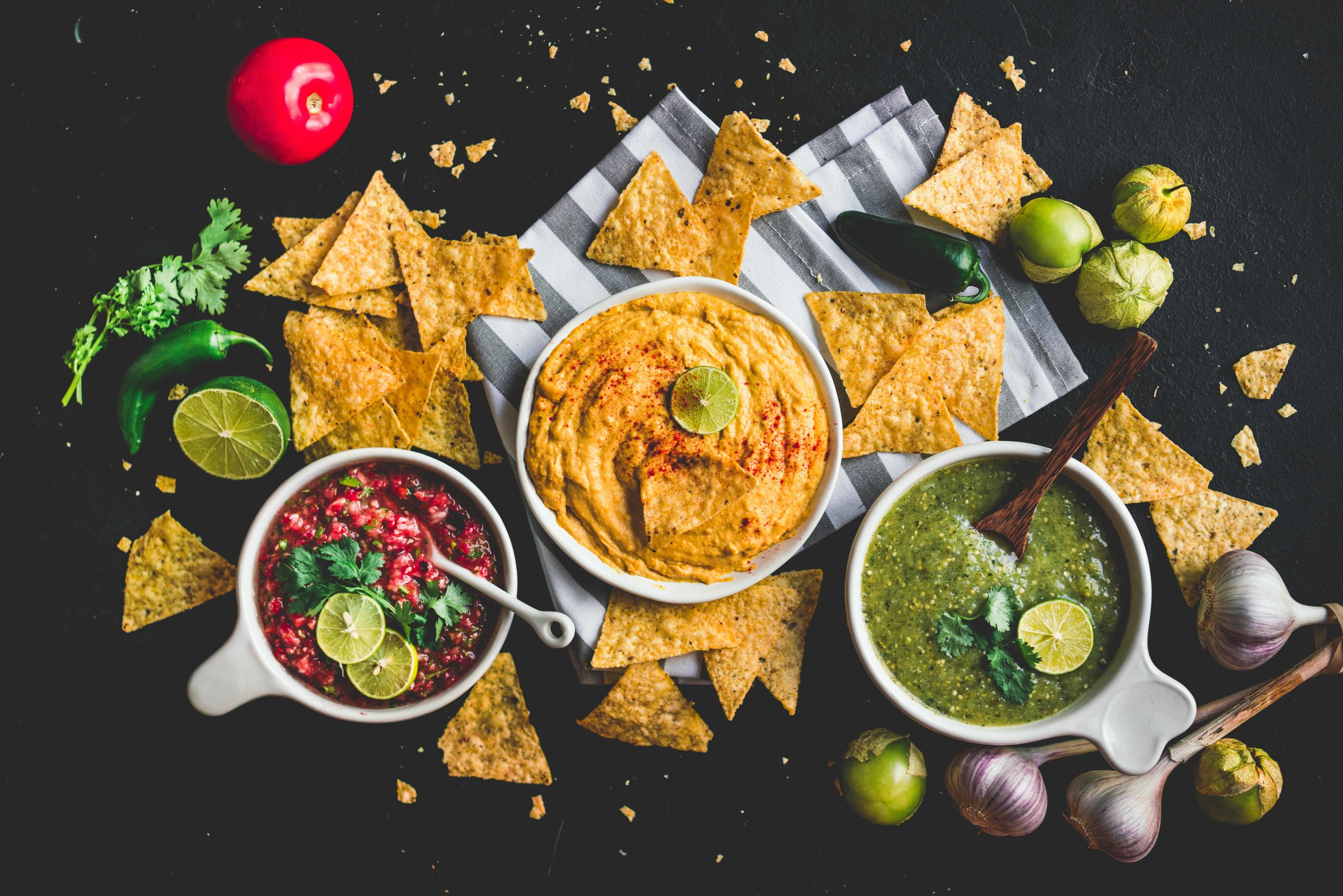 From left to right : classic salsa, cashew queso dip and salsa verde.