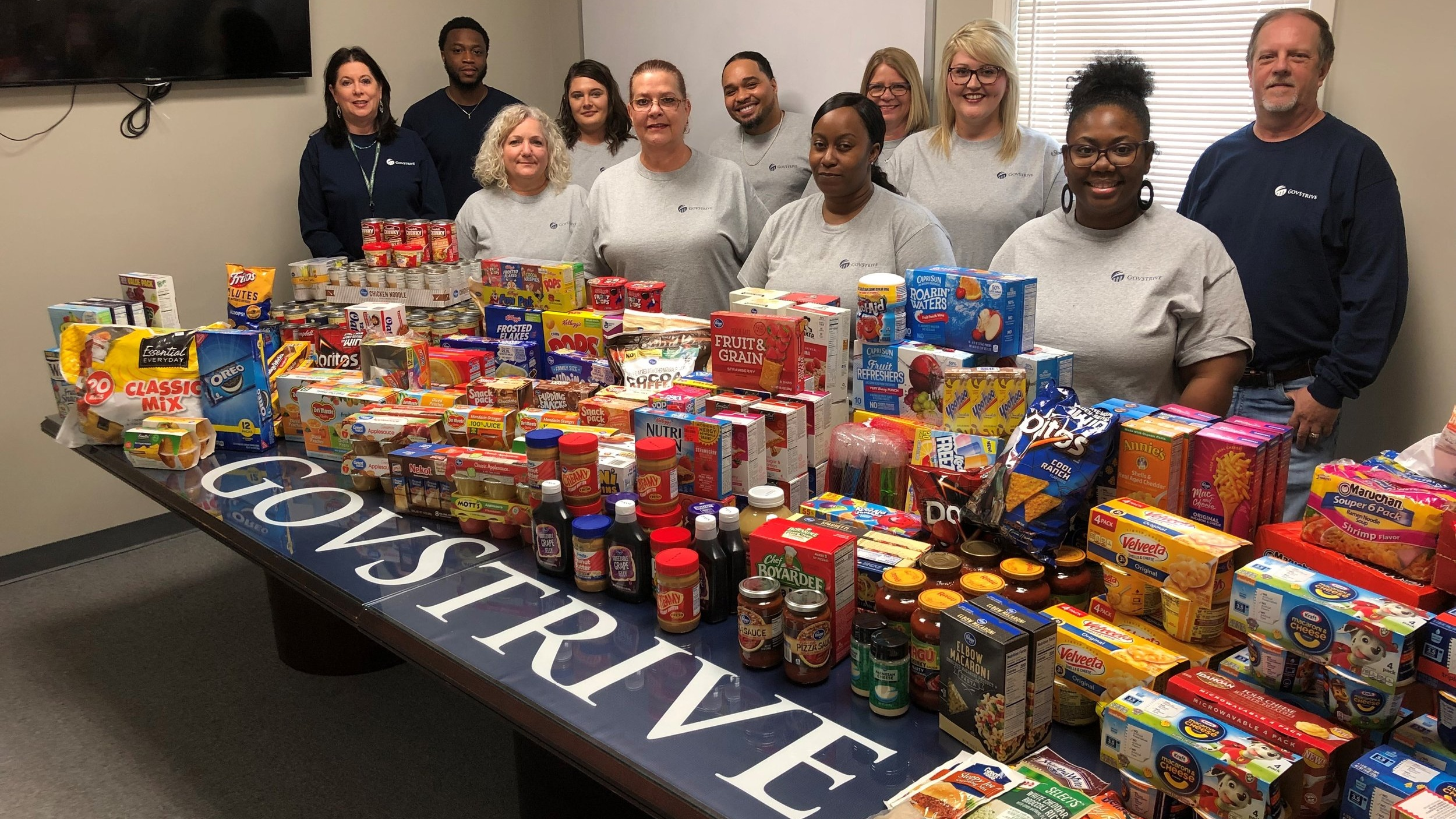 A picture of our Dublin team and the canned and dry food goods they collected for our community.