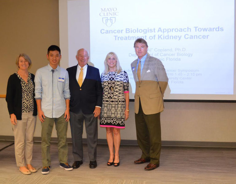 "(Left to right) Marion Zeiner, Episcopal School of Jacksonville; Adrien Zhu, Episcopal School of Jacksonville; Nick Nicholson, Judy Nicholson Kidney Cancer Foundation; Linda Ostoski, Judy Nicholson Kidney Cancer Foundation; Dr. John ""Al"" Copeland III, PhD, Mayo Clinic"