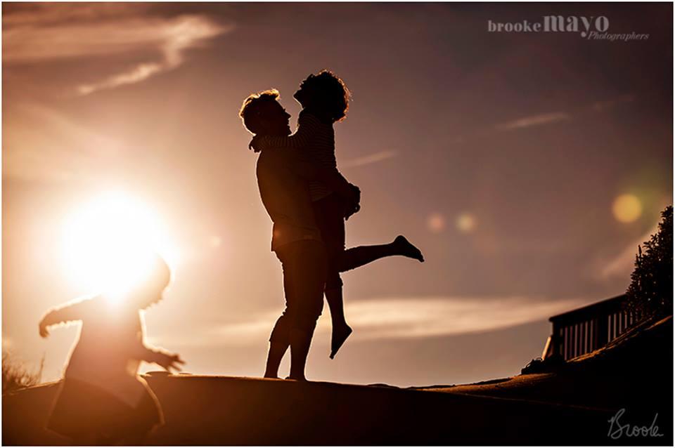Silhouette beach family portrait