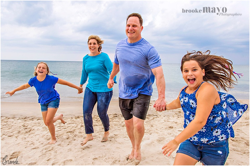 fun family beach portraits on the OBX