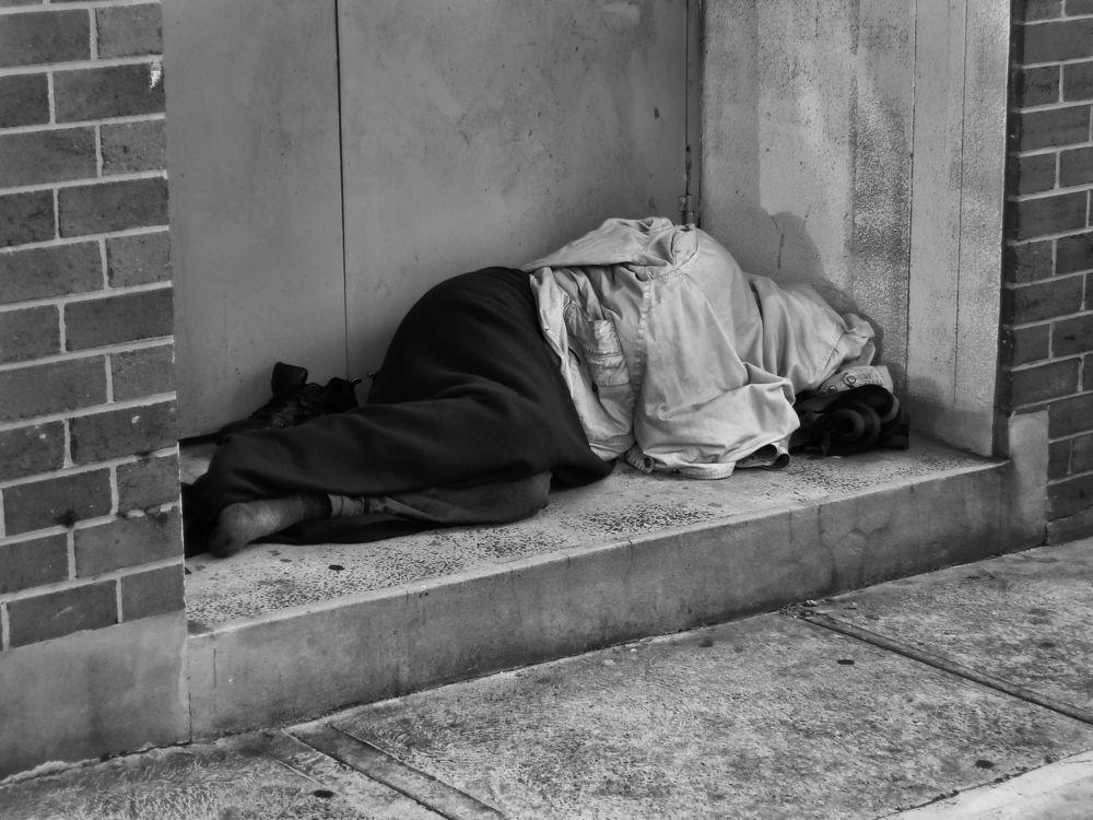 Homeless-Man-Sleeping-in-Doorway.jpg
