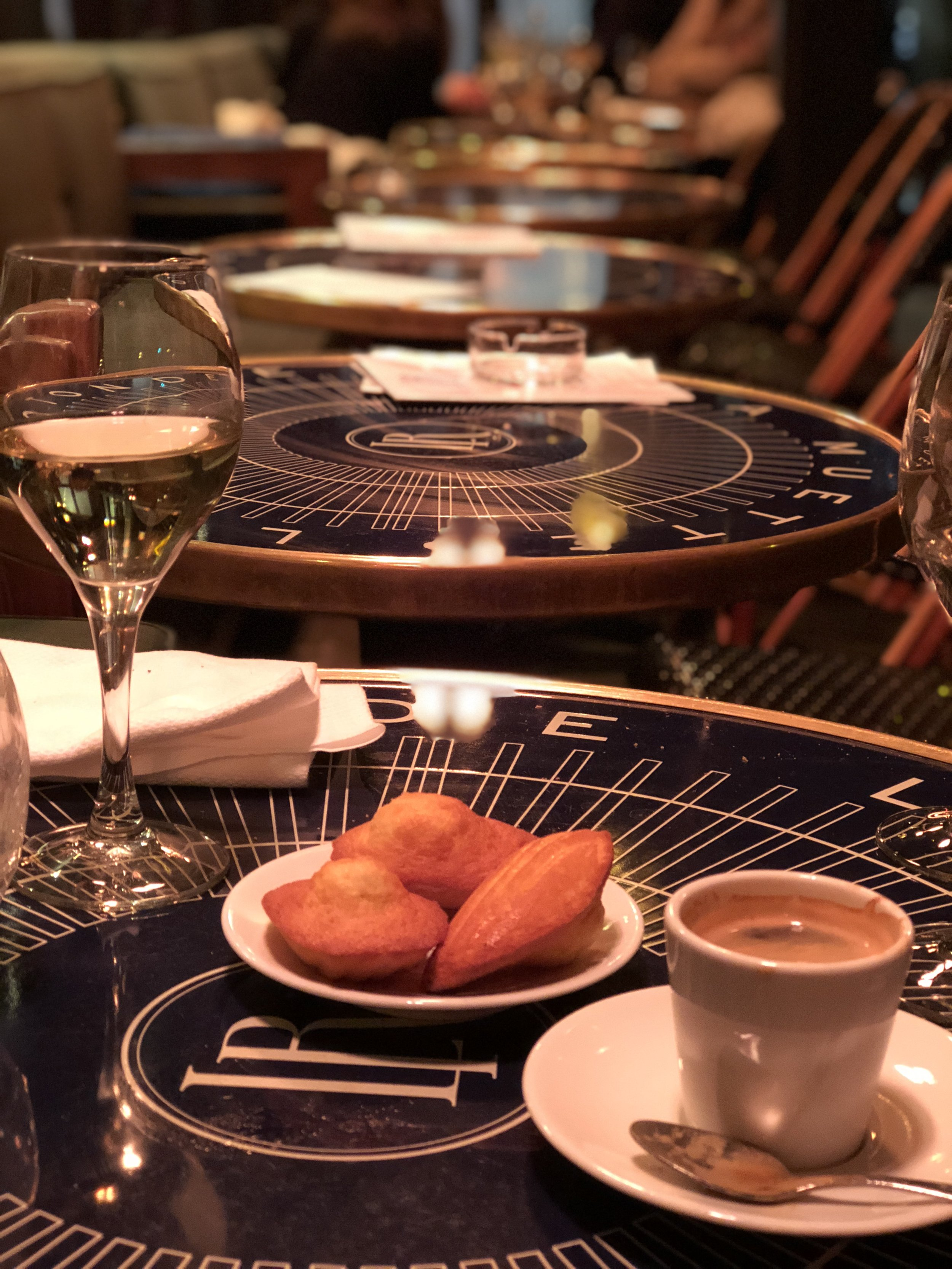 After-dinner coffee and house-made madelines at La Rotonde de la Muette.
