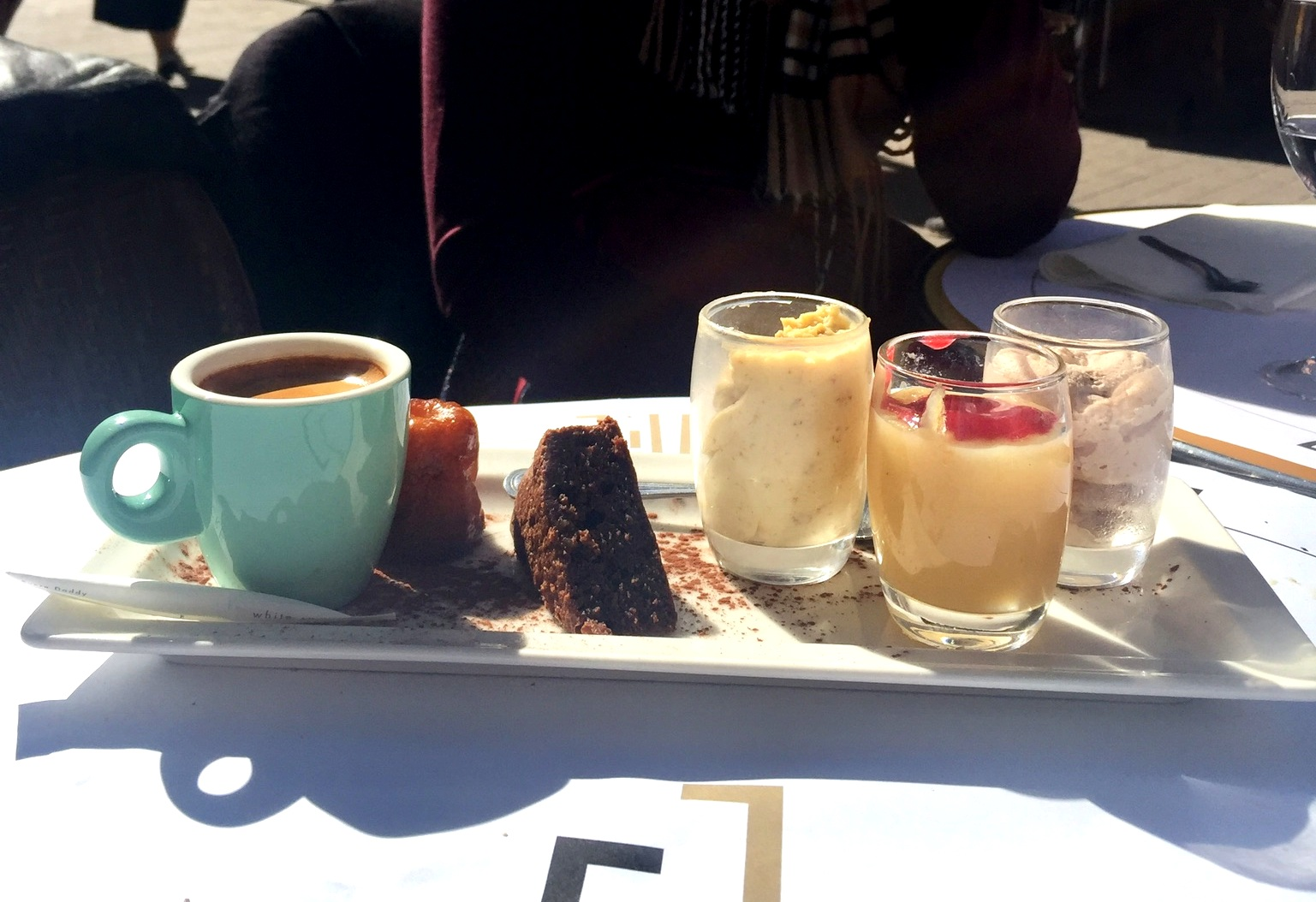 Cafe Gourmand: coffee with mini desserts.