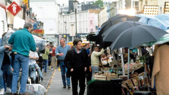 Hugh Grant on the set of Notting Hill (1999).