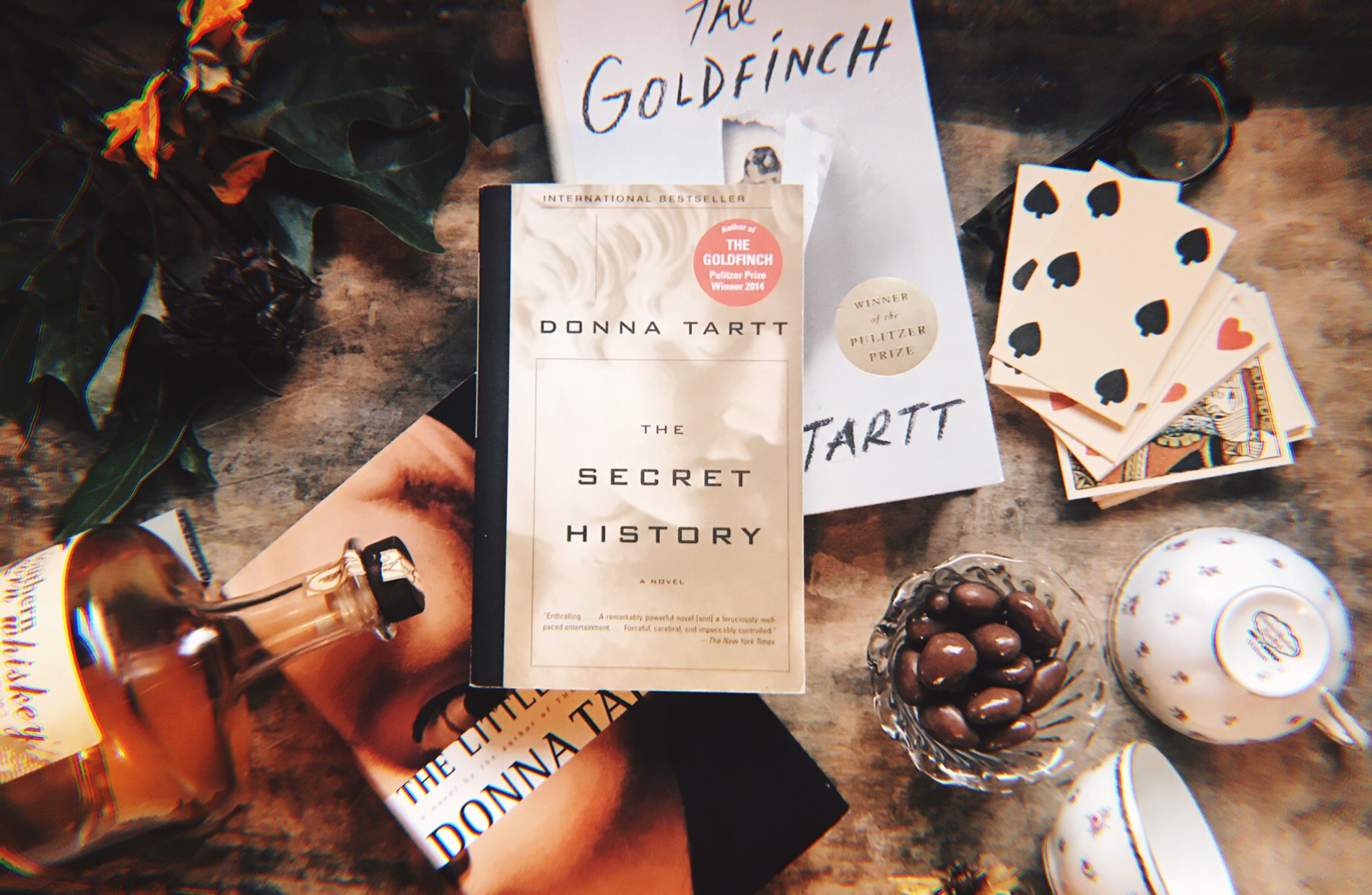 Tartt's novels, and a selection of items mentioned throughout. Photo by Raquel Reyes.