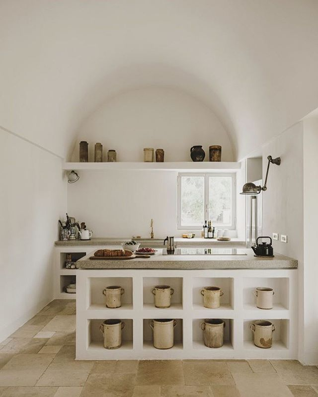"""As you drive down an old country road lined with century old olive trees, you will come to Masseria Moroseta, a white stone house standing proudly on a ridge overlooking the Adriatic Sea and the nearby town of Ostuni. Built with local materials and using traditional techniques, its modern architecture was influenced by the great estates of the Puglian countryside. Surrounded by five hectares of organic olive groves, the farmhouse is an enclave of tranquility and rural simplicity."" #cedrokitchen"