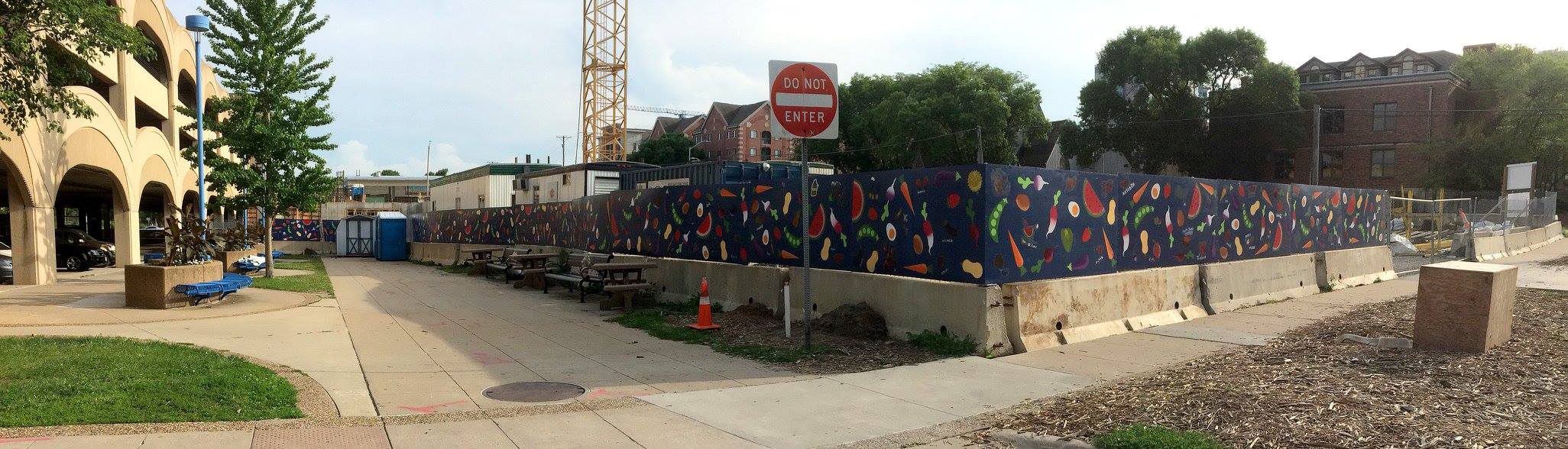 Community mural project for the Iowa City Farmers' Market. This piece included a few hundred participants whose paintings were later laminated to the surface as part of the piece. The rest of the work was stenciled around those paintings in the studio.175' x 4' completed over the course of 3 weeks in June of 2017.