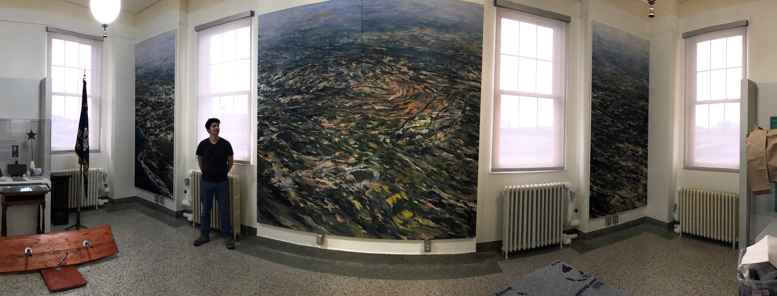 Mural sized painting of an aerial view of Guantanamo Bay, Cuba. A project for the Cedar Rapids Veterans Memorial Building. 4 panels, approximately 10'x20'.