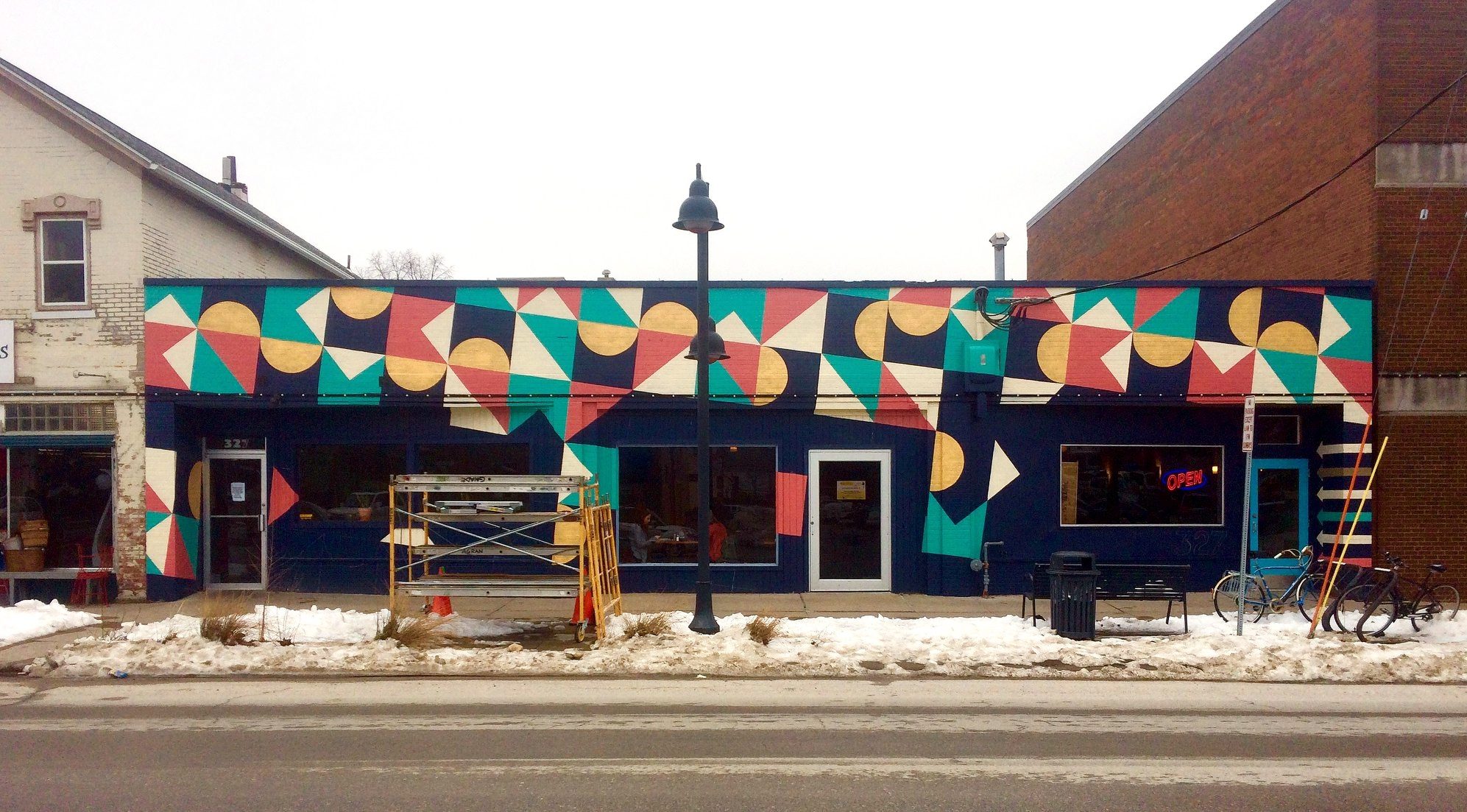 Restaurant façade wrap on Banditos Mexican restaurant in Iowa City. The restaurant formerly occupied only 1/2 of the building, and this project worked to unify the new facade and create a memorable, eye catching, and identifiable street presence.
