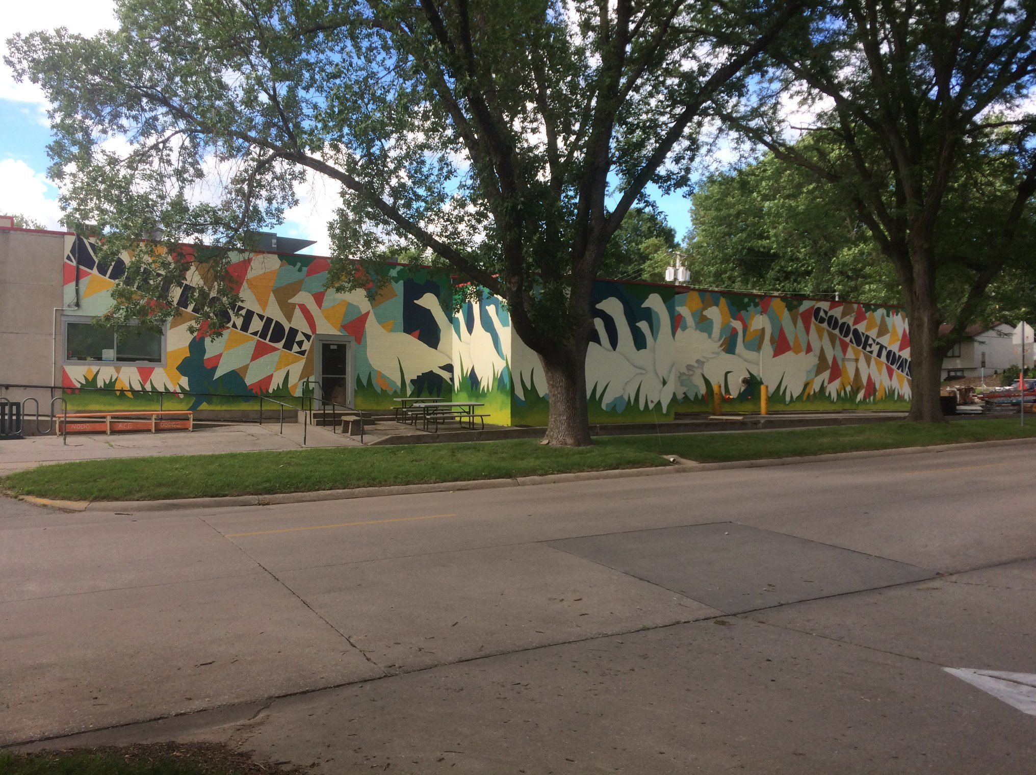 Northside/Goosetown Community Mural, 2018. Painted by 170 neighbors, aged 1 to 86, over the course of a 3 day weekend. The mural celebrates (and renews) the connection between these two historic neighborhoods.