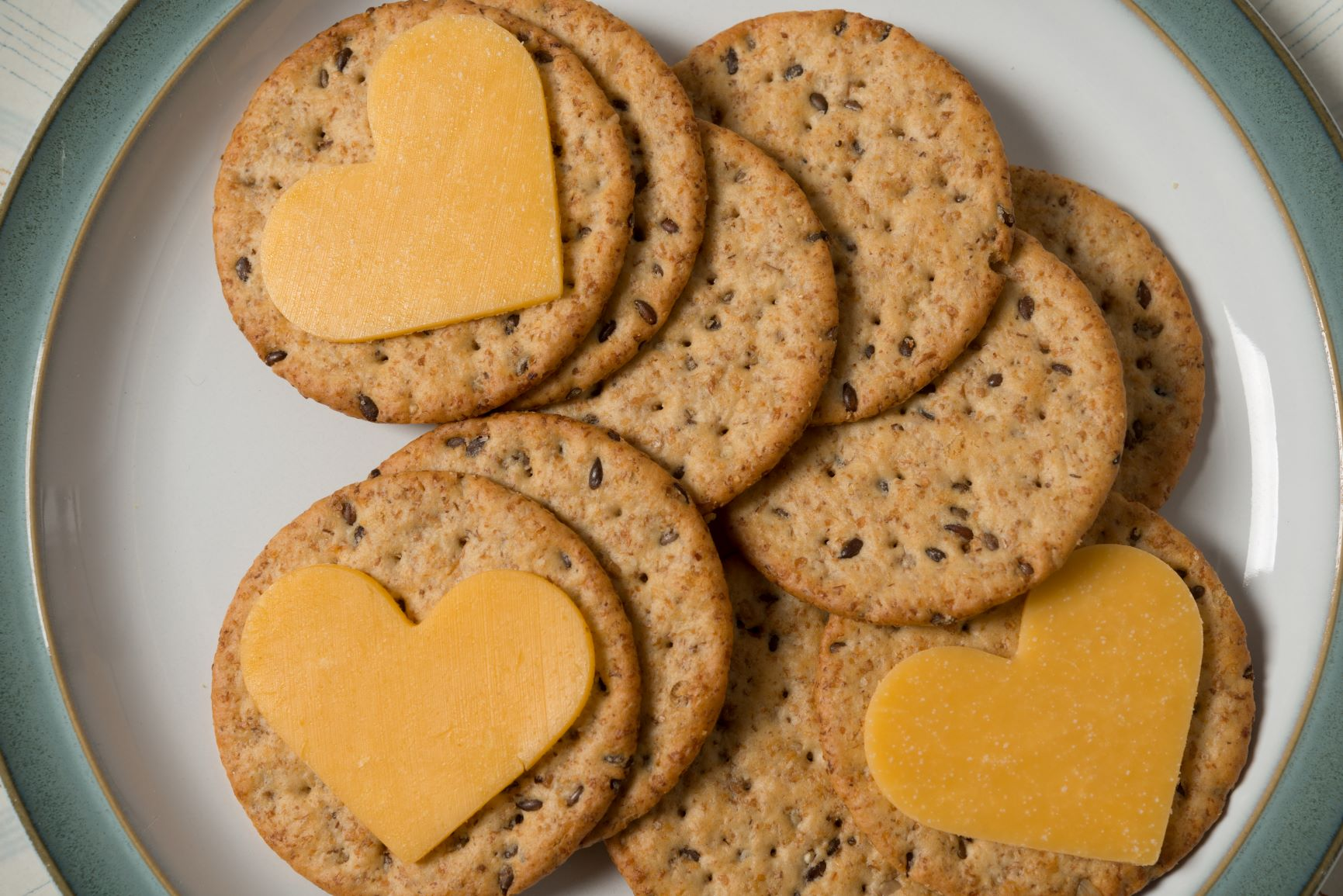 """We eat with our eyes first!"" - Use mini cookie cutters to cut your cheese into cute shapes…. hearts in our example for today because Valentine's Day.What a treat to make your crackers & cheese platters fun, pretty, and DELICIOUS looking!"