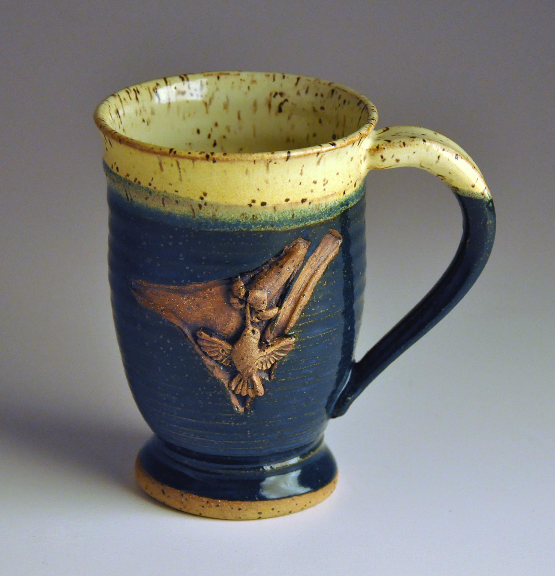 green and cream hummingbird pedestal cup