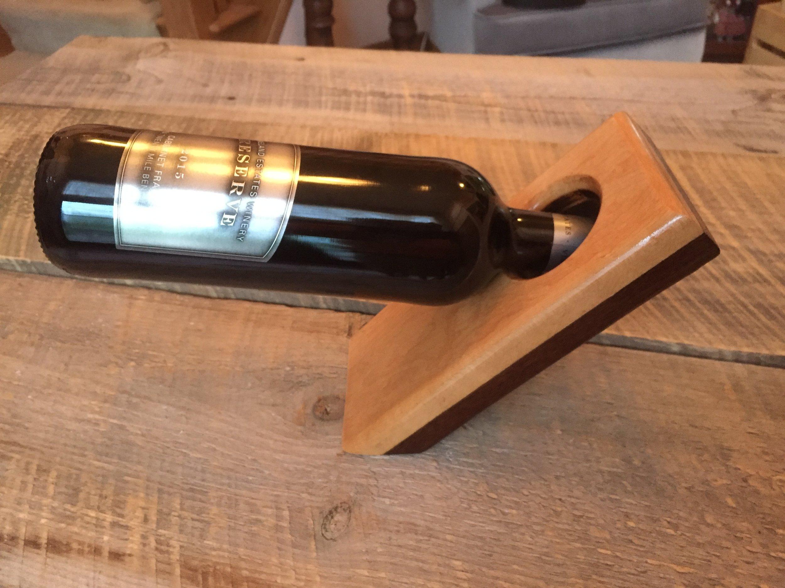 Floating wine bottle holder -